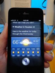 Asking Siri, Apple's new assistant app, for the weather in Houston.