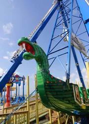 The SeaDragon will swing riders to a maximum height of 50 feet, extending past the edge of the pier over the Gulf water. Various rides on the Pleasure Pier have height restrictions from a minimum of 36-inches tall to 42-, 44- and 48-inches tall for the bigger and faster rides.