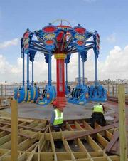 The Skyshooter carries 20 riders — two per car — spinning up in the air nearly horizontal to the ground.
