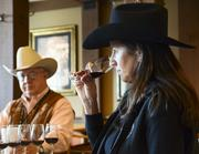 Stephanie Baird, right, general chairman of Rodeo Uncorked!, is an experienced wine judge who showed the Houston media panel the proper tasting techniques. At left is Steve Roe, a Houston Livestock Show & Rodeo vice president.