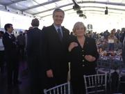 Port of Houston Authority Executive Director Leonard Waterworth and Rice Vice President for Public Affairs Linda Thrane prepare to listen to remarks at Rice University's Centennial Celebration.