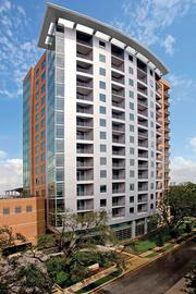 Ziegler Cooper Architects designed Highland Tower, a recently completed 16-story residential tower inside Loop 610 featuring landscaped roof terrace with an infinity edge pool.