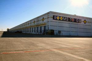 The 1 million-square-foot Rooms To Go distribution center near Katy will gain another 300,000 square feet.