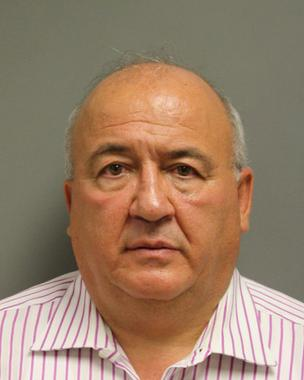 Joseph Andolino, Halliburton's senior vice president of tax, was arrested Oct. 11 in Harris County.