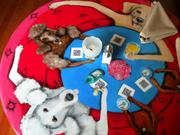 If there are poodles, it must be French, right? A shot of one of several colorful tabletop designs inside Sale-Sucre.
