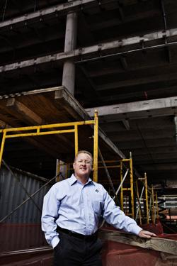 Ronald Mittelstaedt stands near Waste Connections' headquarters building under construction in The Woodlands.