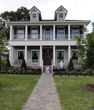 Painters do some last-minute work on the Southern Living Showcase Home at 5307 Aspen in Bellaire prior to this week's public tours, which begin May 4.