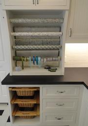 The gift wrapping station inside the upstairs laundry room with extra large linen closets.