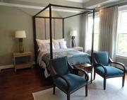 The master bedroom suite at the rear of the home is 24 feet by 15 feet and includes an art alcove.