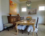 The formal dining room at the front of the home is 15 feet by 13 feet. The rooms feature extra window lighting accents to create as much natural light as possible.
