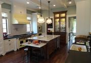 The open concept kitchen — 16 feet by 15 feet — includes vintage enamel Viking appliances, a farmhouse sink, an expansive marble and granite counter workspace, a breakfast area, with adjoining mud room and butler's pantry.