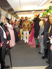 Entrust Energy in Houston had a duos- and groups-themed Halloween party. Tom Gilpin (left center) and Layne Loessin (right center) as '70s disco dancers take a walk down the costume parade.