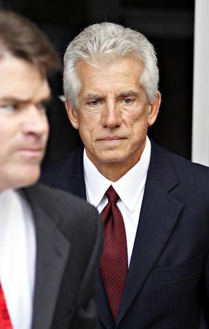 James Davis, at right, former CFO of Stanford Financial Group, is shown in this file photo leaving the  Bob Casey Federal Courthouse in Houston in 2009. On Jan. 22 he was sentenced to five years in prison for his role in a $7 billion Ponzi scheme.