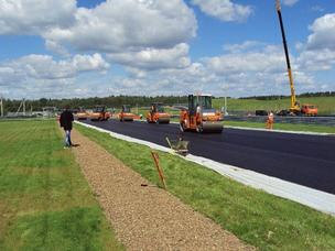 Rollers put final touches on pavement compaction at the Moscow Raceway. The pavement was designed by Houston-based Kraton Performance Polymers.
