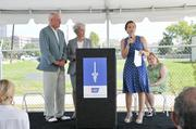 Bob and Janice McNair (left) and Betti Guzman, American Cancer Society regional vice president (right), speak at the Aug. 29 kickoff.