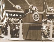 President John F. Kennedy delivers his famous speech at Rice Stadium, promising a U.S. moon landing by the end of the decade.