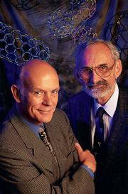 "Professors Richard Smalley (left) and Robert Curl discover ""buckyballs"" while trying to simulate the composition of stars. The finding significantly helped redefine physics."