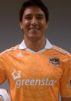 Dynamo player Brian Ching models the new Greenstar-sponsored jersey.