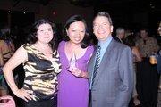 40 Under 40 honoree Miya Shay (center) poses with her award.