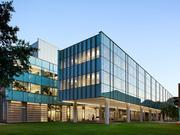 Brockman Hall for Physics is a sustainable research facility on the Rice University campus, with one elevated bar that preserves the landscape.