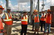 Dynamo president Chris Canetti, center, gave a tour of the stadium site this week to a group of Houston Dynamo players.