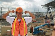 Houston Dynamo defender Bobby Boswell hams it up for the camera during the Houston Dynamo stadium tour. The grandstand is taking shape in the background at right.