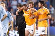 The Dynamo's victory over Kansas City came at a cost, as star midfielder Brad Davis was injured and will miss the Nov. 20 championship game.