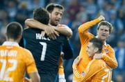 Houston Dynamo team members celebrate after defeating Sporting Kansas City on Nov. 6 to advance to the Major League Soccer championship on Nov. 20.