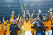 Houston Dynamo captain Brian Ching hoists the Eastern Conference championship trophy after the team beat Sporting Kansas City 2-0. The team plays the L.A. Galaxy on Nov. 20 for the Major League Soccer championship.