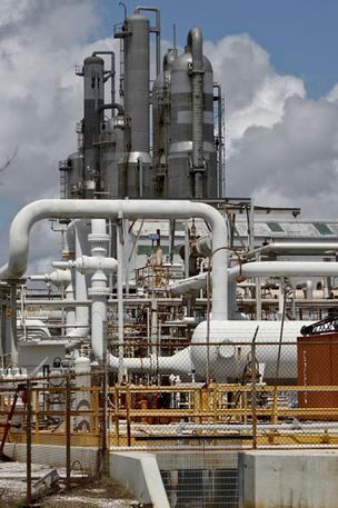 Photo: Bloomberg. Enterprise Products Partners LP (NYSE: EPD) saw fourth-quarter net income and revenue take a hit from lower natural gas prices and production. Pictured: An Enterprise natural gas processing facility in Yscloskey, La.