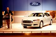 Ford's manager of electrified power train, Rob Iorio, talks about the company's 2013 Fusion Energi. The car boasts a hybrid engine capable of getting 108 miles to the gallon and can run 21 miles on battery power alone.