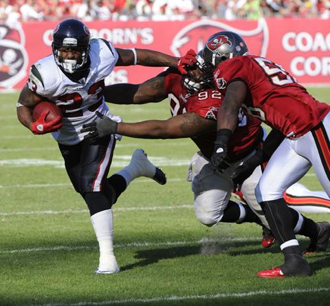 The Houston Texans, helped by the play of all-star running back Arian Foster, left, are valued at $1.2 billion.