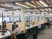 """The Houston Permitting Center's renovation project was designed to be a """"one-stop shop"""" to create a more pleasant and comfortable permitting experience for both the public, and the employees, by providing a user-friendly environment that fused the building's original design elements with a modern twist."""