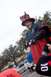 "Known to his compatriots in the Blue Crew Tailgate party as ""Joe Texan,"" Joe Banowsky explains before the game how the Texans will send the Bengals packing for a second time."