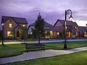 Lakeland Heights is an urban housing community integrating Craftsman, English Tudor, Classical and French styles into its homes, all surrounded by shops, parks, restaurants and an entertainment venue to create a walkable and different community to live in.