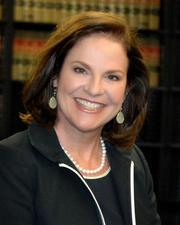 Laura Gibson is a founding partner of Ogden, Gibson, Broocks, Longoria & Hall LLP in Houston. She is board-certified in labor and employment law. She currently serves on the board of directors of the State Bar of Texas. She also serves on the board of directors of the Houston Bar Association.