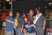 McCoy Workplace Solutions' carnival-themed Christmas party featured a photo booth, a caricature artist and many games and prizes. Pictured from left: Francisco Maldonado, Ruben Martinez, Francisco Ramirez (peeking in the back), Jose Marquez, Pedro Alaniz Jr. and Bobby Cano.