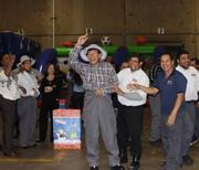 McCoy Workplace Solutions' carnival-themed Christmas party featured a photo booth, a caricature artist and many games and prizes. Pictured: Peggy Kemp, Tracey Bailey, Kristie Trice, Oscar Juarez, Julio Herrera, Juan Contreras and John Mendoza.