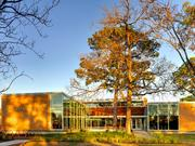 The Oak Forest Neighborhood Library's new north entry connects the existing structure to the addition and has helped knit together the Oak Forest residential community and elementary school.