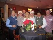 PBK held its Christmas party at Bowl 300. Pictured from left: Ian Powell, Darrick Jahn, Brad Berger, Donna Range, Ryan Gregory, Juan Lopez and Scott Klaus.