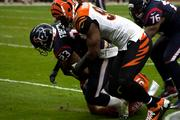 Texans' running back Arian Foster goes down at the hands of two Bengals.