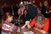 During TopSpot Internet Marketing's holiday party at The West End, Julia Alaniz (left) and Whitney Kane participated in an impromptu arm-wrestling contest.