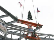 Cranes lift the final girder for the canopy at the Houston Dynamo stadium into place.