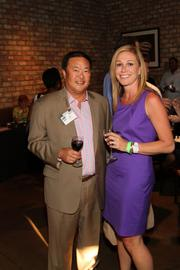 From left: John Kim and Denise Mitchell of the Kim Law Firm.