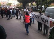 """Protesters shouted, """"Pay your taxes,"""" outside of the CERAWeek event."""