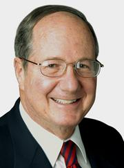 Economist Bud Weinstein says the DOJ's lawsuit against the merger caught people by surprise.