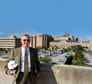 UTMB Vice President Michael Shriner overlooking where the $438 million Jennie Sealy Hospital will be built.