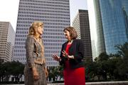 Niloufar Molavi, left, and Anne Taylor run the Houston offices of their competing accounting firms.