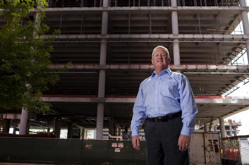 Ronald Mittelstaedt in front of 3 Waterway Square, which is under construction in The Woodlands and where his company will move into once it is built.