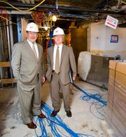 UTMB Executive Vice President William Elger, left, with Shriner, on the third floor of the John Sealy Hospital's new Labor and Delivery Unit, to be completed in November.